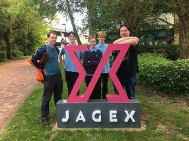 Students from Parkside school in Cambridge visiting Jagex are, from left, Adam Biltcliffe, Mathematics and Computing teacher, Parkside; Joshua Ball (aged 15), Klara Kangametsa (aged 14), Douglas Tennant (aged 14),plus Mark Ogilivie, Design Director, Jagex.