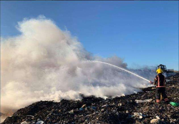 A firefighter tackles the blaze at the landfill site in Milton. Picture: Cambs Fire and Rescue Service