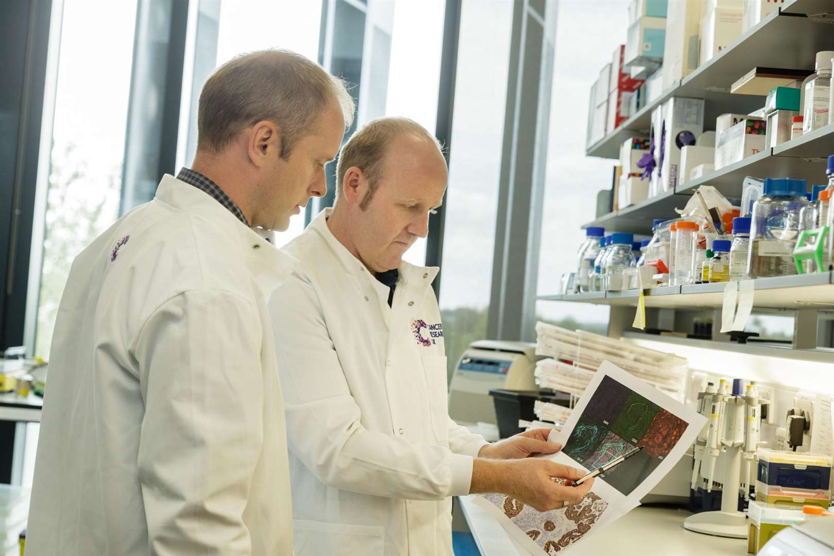 Dr Martin Miller and Dr Michael Gill studying images at Cancer Research UK Cambridge Institute (5680763)