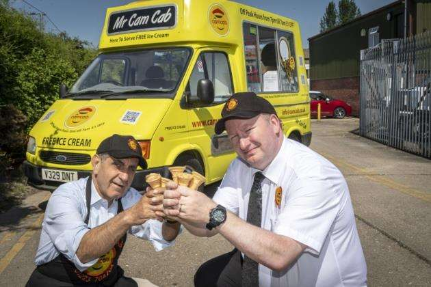 Mr Cam Cabs with owner of Cam Cabs Rowhi Nemer and manager Colin Gelling. Picture: Keith Heppell