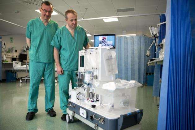 From left Professor Chris Watson, and Hon Consultant Andrew Butler with the new machine. Picture: Keith Heppell