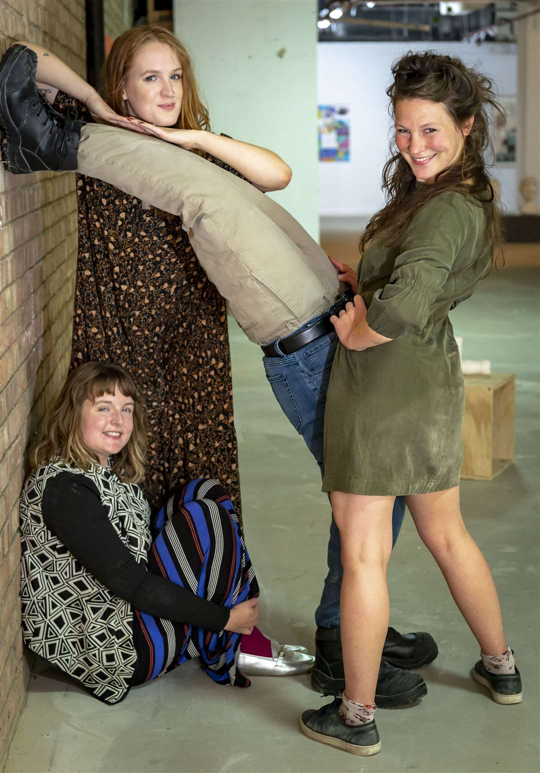 From left: Ellie Breeze and Arabella Hilfiker with crouching Denise Kehole and a rather strange leggy piece of artwork. Picture: Keith Heppell. (15883874)