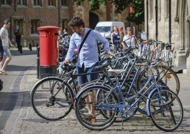16 06 16 Student and bikes on Trinity Street, Cambridge. Picture: Keith Heppell