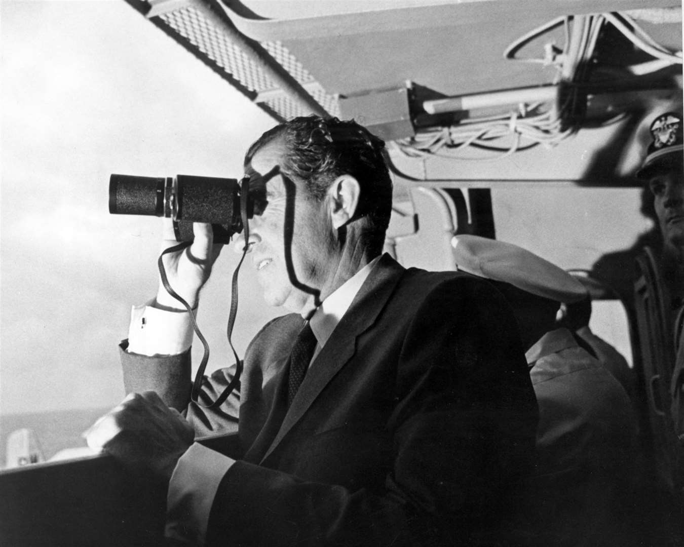 U.S. President Richard Milhous Nixon, aboard the U.S.S. Hornet aircraft carrier, used binoculars to watch the Apollo 11 Lunar Mission recovery. The recovery operation took place in the Pacific Ocean where Navy para-rescue men recovered the capsule housing the 3-man Apollo 11 crew. The crew was airlifted to safety aboard the U.S.S. Hornet, where they were quartered in a Mobile Quarantine Facility (MQF) for 21 days post mission. Picture: NASA (14042150)