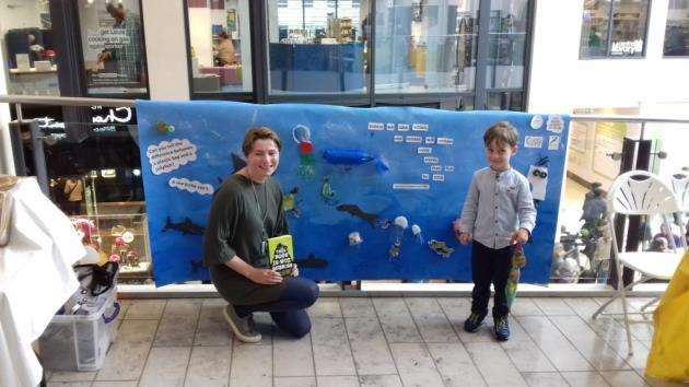 Author Isabel Thomas and visitor Hugh with the mural created earlier in the day at a waste-art workshop in the Museum of Zoology. Picture: Mike Scialom