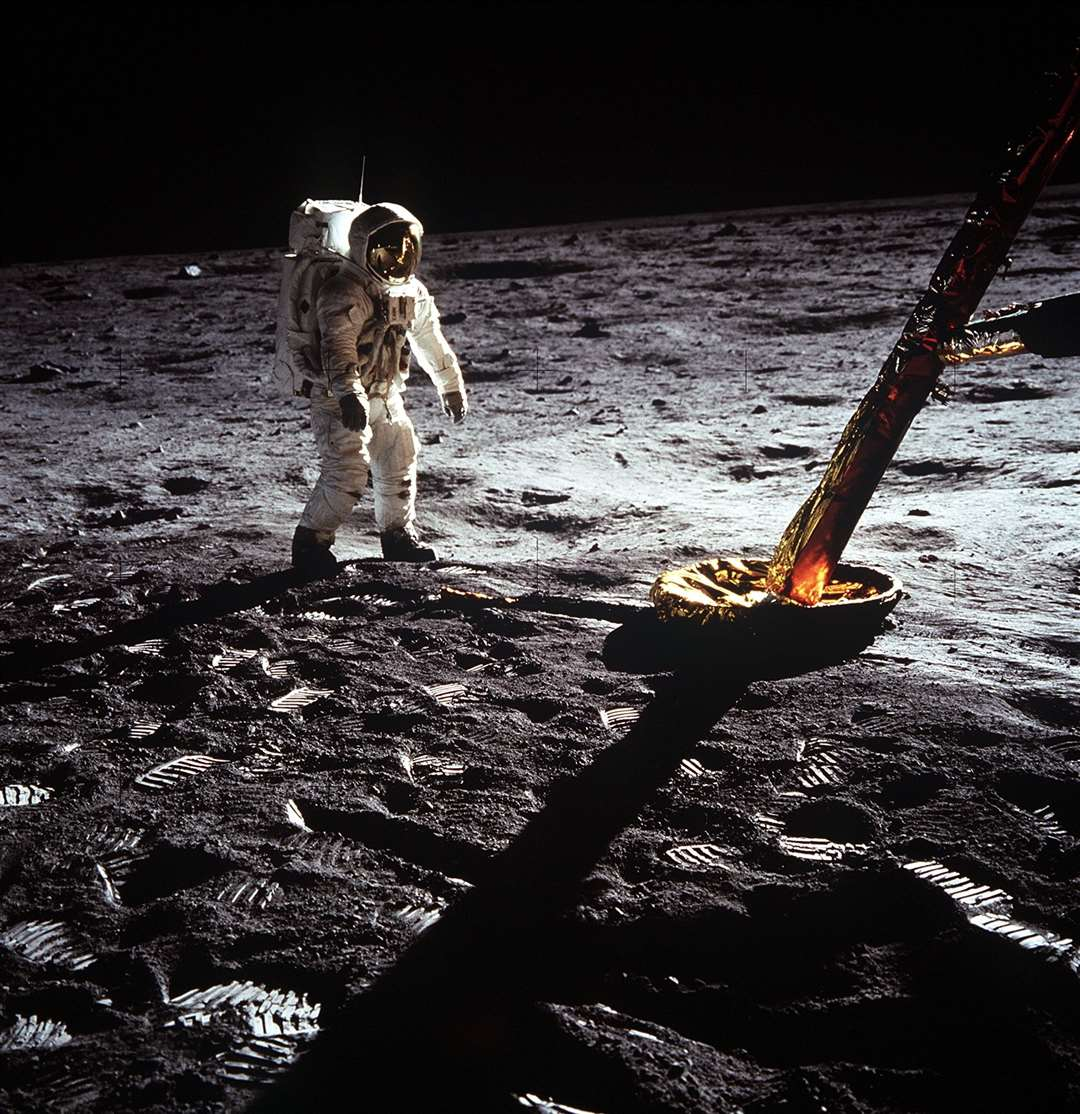 Astronaut Edwin E. Aldrin Jr., lunar module pilot, moves toward a position to deploy two components of the Early Apollo Scientific Experiments Package (EASEP) on the surface of the Moon during the Apollo 11 extravehicular activity. The Passive Seismic Experiments Package (PSEP) is in his left hand; and in his right hand is the Laser Ranging Retro-Reflector (LR3). Astronaut Neil A. Armstrong, commander, took this photograph with a 70mm lunar surface camera. Picture: NASA (14042115)
