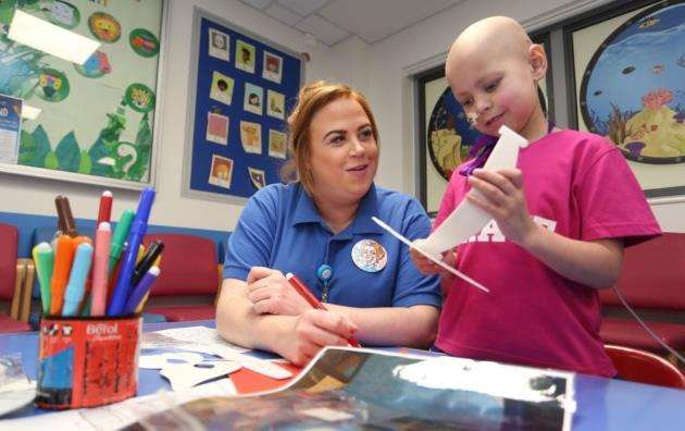 Trainee Play Specialist, Jade Allard plays with patient, Lulu de Vries, 5, at the newly refurbished Paediatric Day Unit at Addenbrookes Hospital. Picture - Richard Marsham