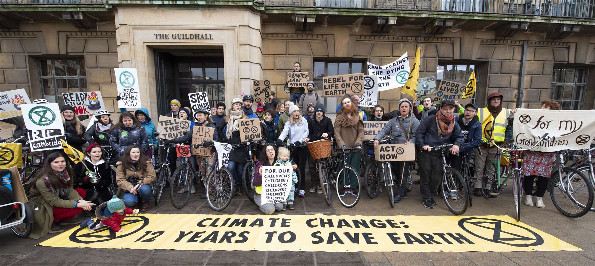 Extinction Rebellion action - critical mass bike ride through Cambridge, seen here as they arrived at the Guildhall. Picture: Keith Heppell. (9816059)