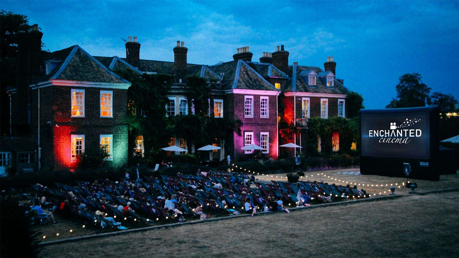 The Gonville Hotel lit up for an Enchanted Cinema outdoor screening