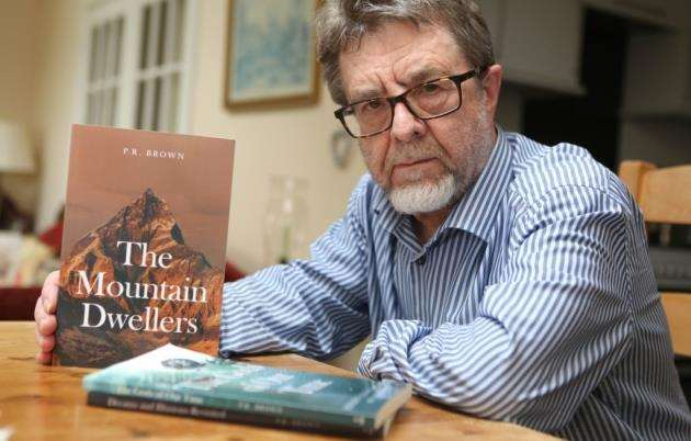 Dr Phillip Brown with his new book The Mountain Dwellers Pic- Richard Marsham
