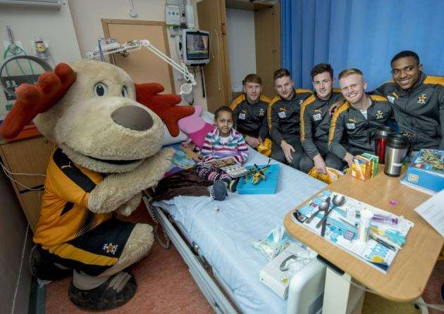 Cambridge United players on the childrens wards at Addenbrookes . Picture: Keith Heppell
