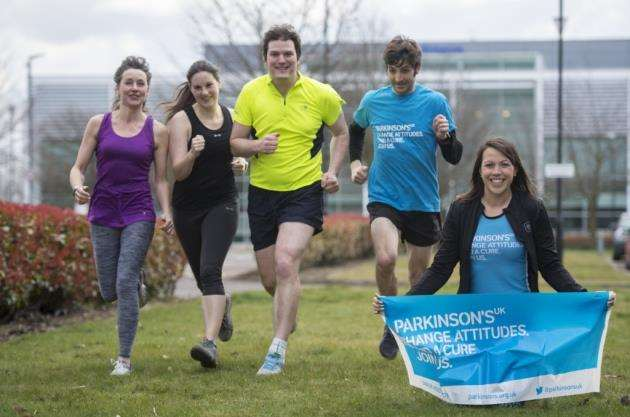 Annabel Bradford, volunteer publicity officer for Parkinsons UK, Cambridge, promoted the Tulip Fun Run with the help from her colleagues at Redgate, from left Ros Legge, Annabel Bradford, Clare Walsh, Sam Blackburn and Alex Bartley. Picture: Keith Heppell