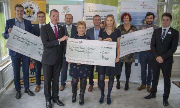 Cheque presentations to charities benefiting from Cambridge Roar: Cambridge United Community Trust, Arthur Rank Hospice and East Anglian Air Ambulance. Picture: Keith Heppell
