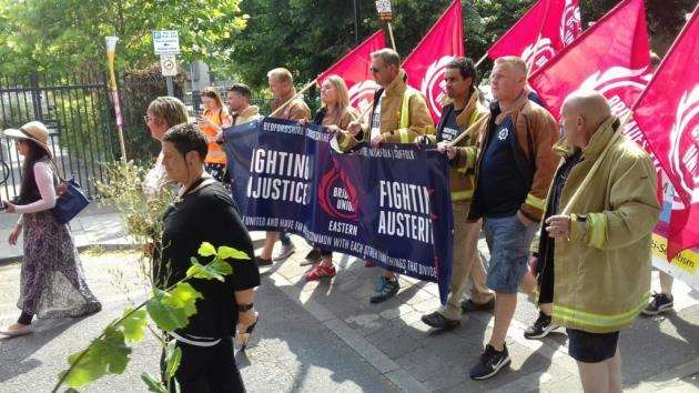 Stand Up Against Racism Norfolk Street, Fire Brigades Union - Riccardo La Torre, regional secretary for the Fire Brigades Union Eastern region, is on the end of the line fon the right, next to the volunteer in orange