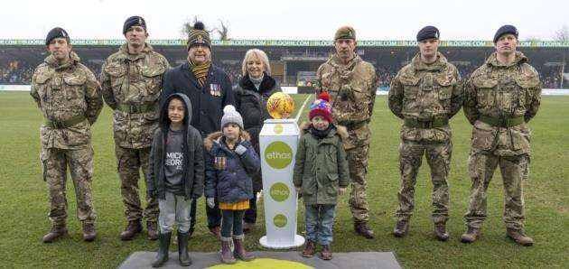 Soldiers, children and organiser Vanessa Burkitt on the pitch. Picture: Keith Heppell