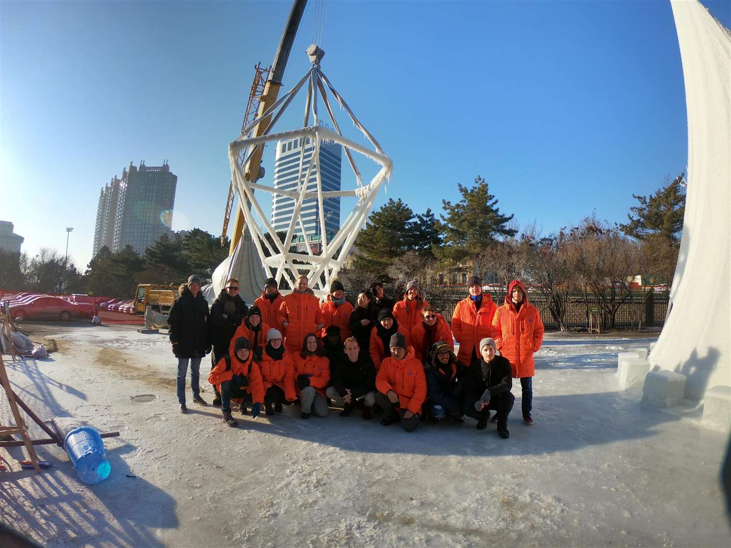 The team in front of their ice structure
