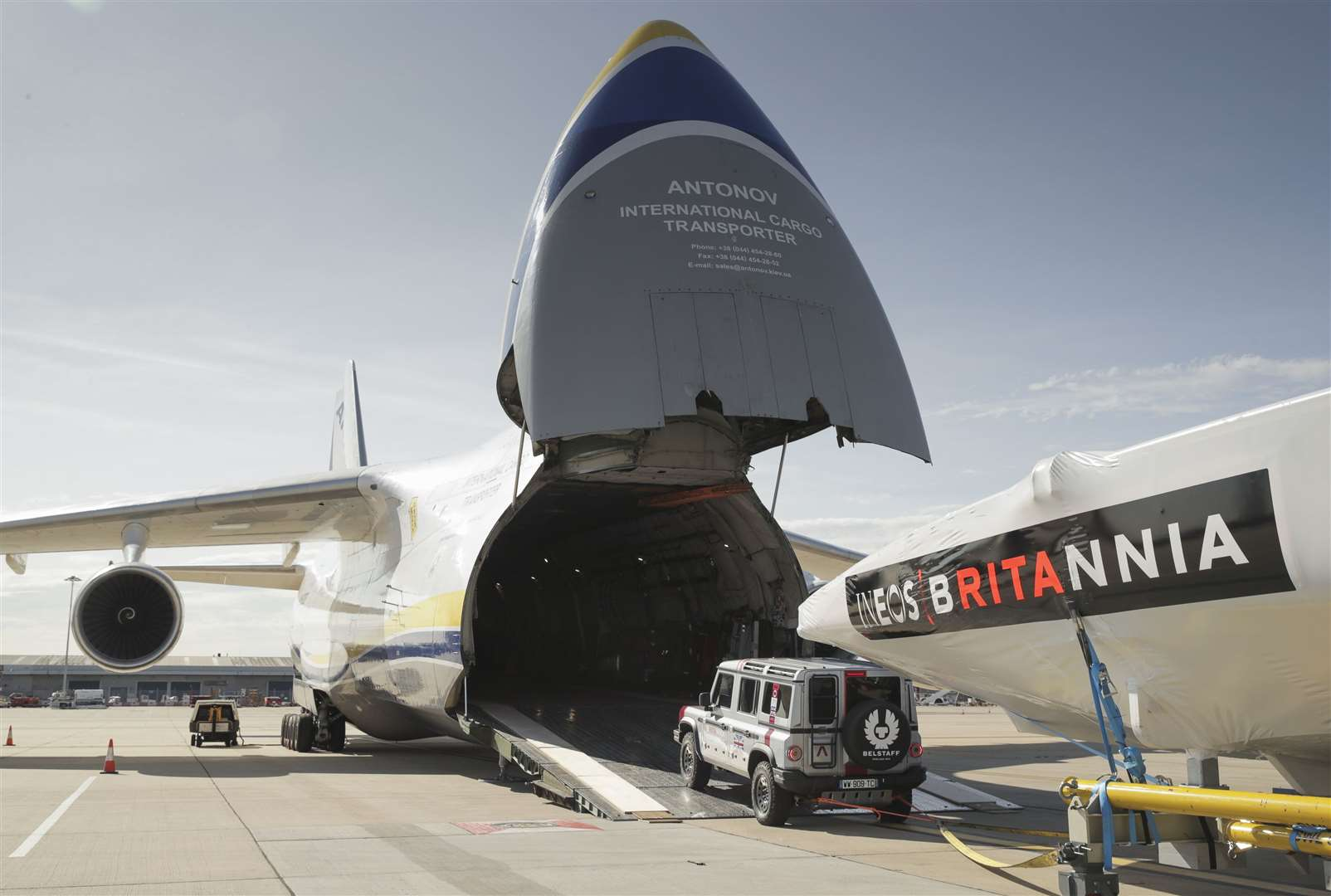 The INEOS TEAM UK America's Cup race boat being towed onto an Antonov cargo plane by the teams new prototype INEOS 'Grenadier' 4x4 at the start of its journey to Auckland, New Zealand.