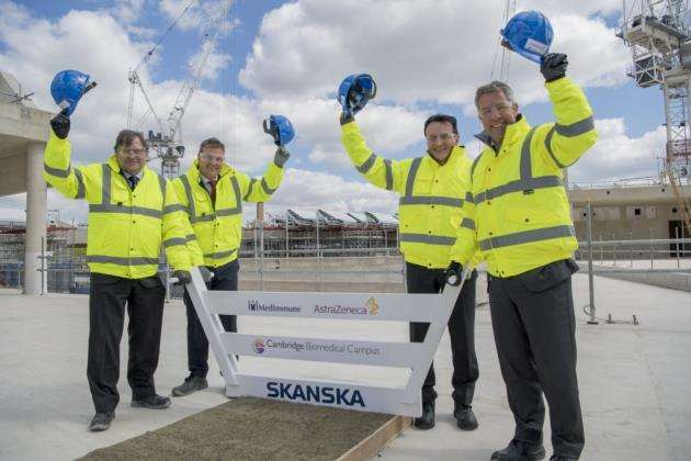 AstraZeneca Cambridge Biomedical Campus, topping out, from left Duncan Maskell, Anders Danielsson, Pascal Soriot, and Mene Pangalos . Picture: Keith Heppell