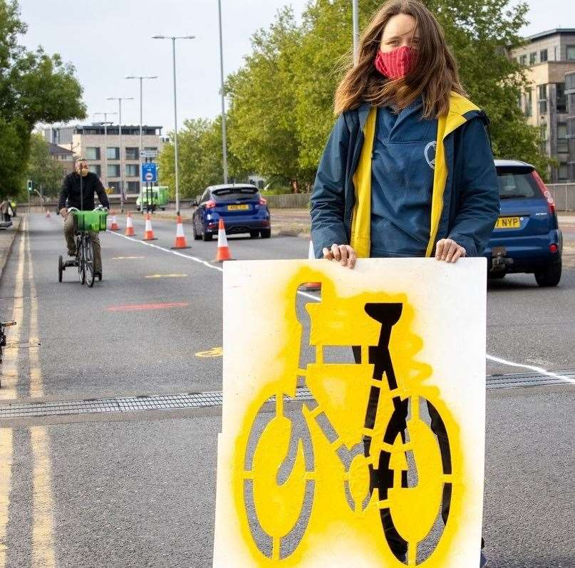 Extinction Rebellion activist on Elizabeth Way with stencil for installing on-road cycle lane signage. Picture: Jeremy Peters