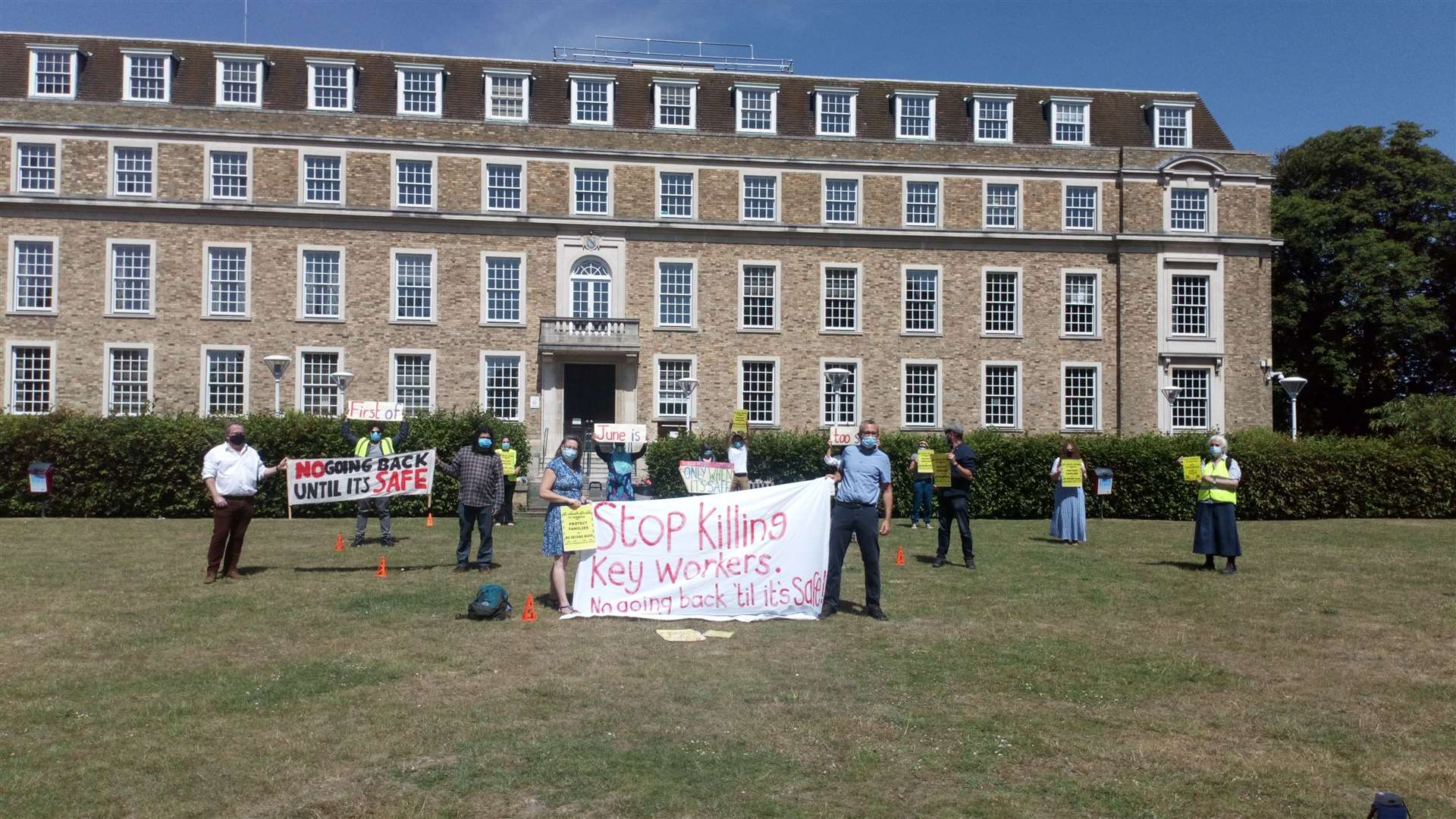 Protesters against the reopening of primary schools on June 1 outside Shire Hall in Cambridge