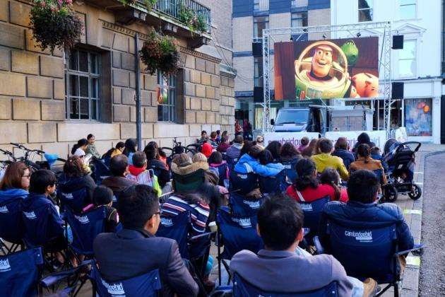 An open air cinema and night market in the market square, Cambridge, organised by Cambridge BID. Picture: Richard Marsham/RMG Photography