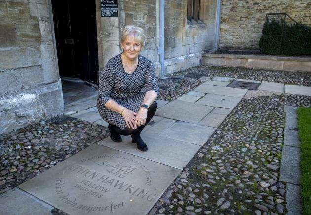 Dr Pippa Rogerson, master of Gonville & Caius, with the memorial that has been placed at the entrance to Prof Stephen Hawkings room at the college where he was a fellow. Picture: Keith Heppell