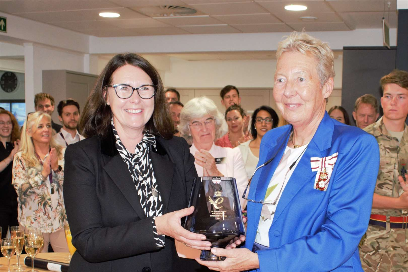 Martina King, CEO of Featurespace, receives the Queen's Award from Lord Lieutenant Julie Spence.  Image: Featurespace