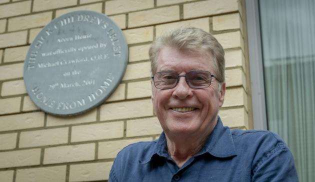 Michael Crawford at Acorn House beside the plaque which he unveiled when he opened Acorn House in March 2001. Picture: Keith Heppell
